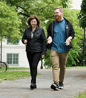 A student walking with a study and career counsellor