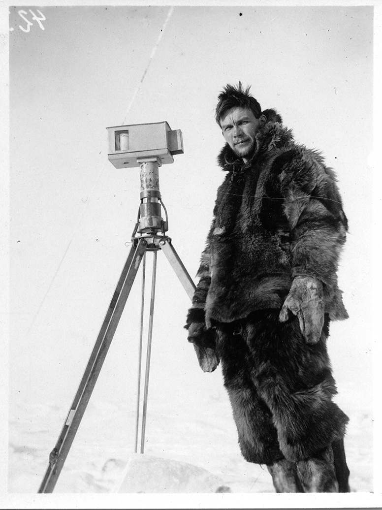 Finn Malmgren stands on the ice by his hoarfrost measure instrument