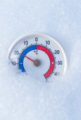 A Celsius thermometer lying in the snow